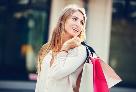 Photo for Attractive happy young woman shopping at the mall - Royalty Free Image