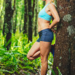 Athletic Woman Stretching Before going for Run in ...