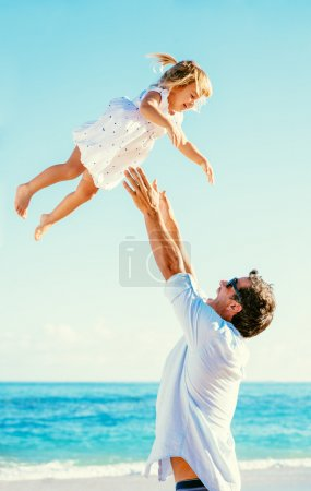 Father and Daughter Having Fun at the Beach