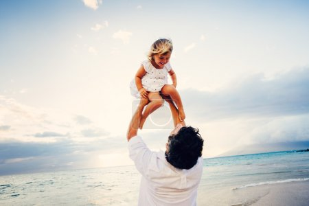 Photo for Healthy Father and Daughter Playing Together at the Beach at Sunset. Happy Fun Smiling Lifestyle - Royalty Free Image