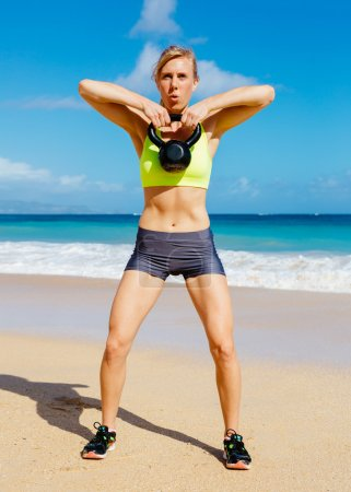 Woman Doing Kettle Bell Workout