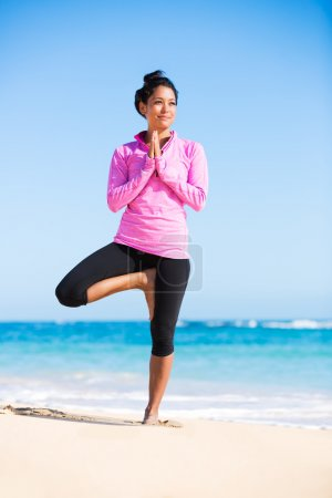 Photo for Beautiful young woman in yoga pose at the beach. Morning zen mediation outdoors. Practicing yoga. Healthy Active Lifestyle Concept. - Royalty Free Image