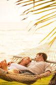 """Постер, картина, фотообои """"пара отдыха в тропических гамак"""""""