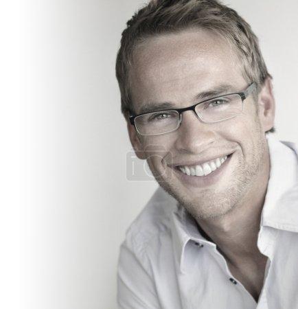 Happy man in glasses