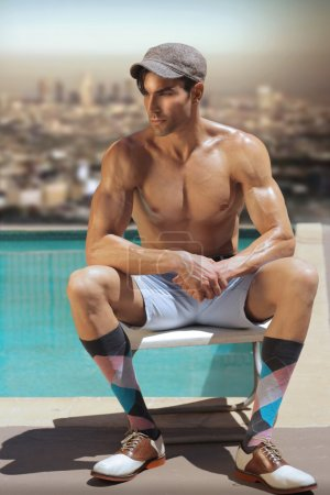 Photo for Fashion portrait of shirtless male model at pool with retro cool look and styling - Royalty Free Image