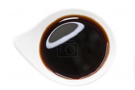Photo for Japanese or Chinese Soy Sauce in Suace-boat. Isolated over White - Royalty Free Image