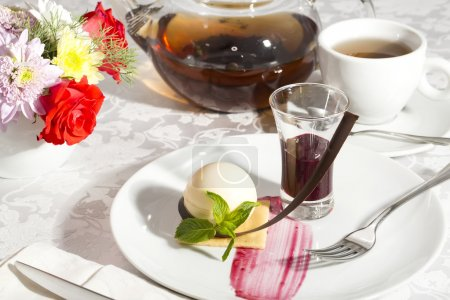 Cream dessert garnished with mint