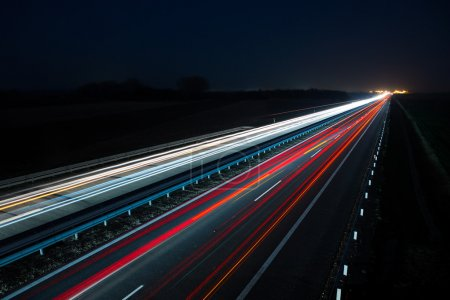 Photo for Night highway with car traffic and blurry lights when long exposure - Royalty Free Image
