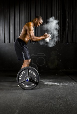 Photo for Young athlete trains with crossfit equipment - Royalty Free Image