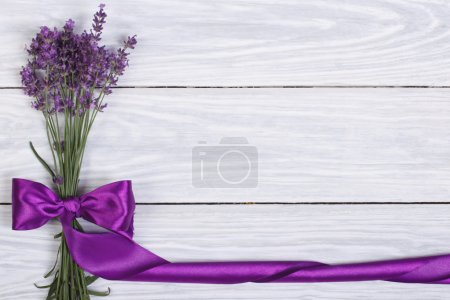 Photo for Floral frame from flowers of lavender and purple ribbon - Royalty Free Image