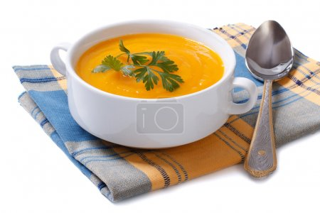 Photo for Pumpkin soup on a napkin isolated on white background - Royalty Free Image