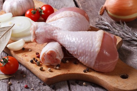Raw chicken legs and marinade ingredients