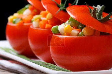 Photo for Vegetarian food: tomatoes stuffed with fresh vegetables. macro. horizontal. low ke - Royalty Free Image