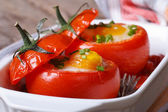 Tasty appetizer of baked tomatoes stuffed with eggs