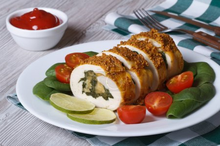 chicken breast stuffed with spinach and cheese on a plate