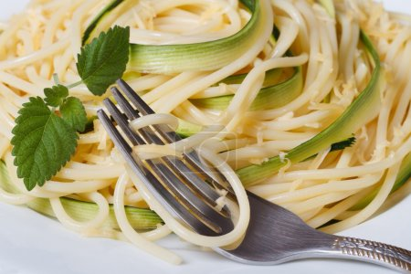 Italian pasta spaghetti with zucchini  and a fork macro