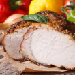 Tasty juicy roast pork tenderloin and fresh vegeta...