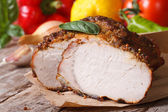 Tasty juicy roast pork tenderloin and fresh vegetables