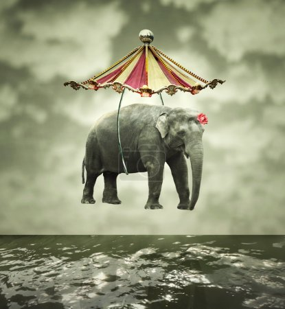 Photo for Fanciful and artistic image that represent a flying elephant with circus tent above the water - Royalty Free Image