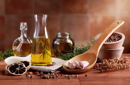 Photo for Olive oil flavored with spices and other ingredients - Royalty Free Image