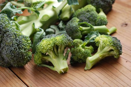 Photo for Green broccoli on wood table - Royalty Free Image