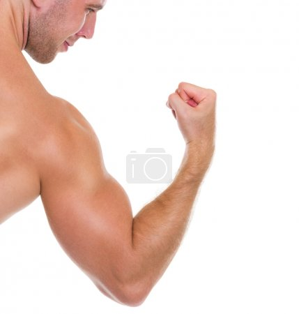 Photo for Closeup on muscular man showing biceps - Royalty Free Image