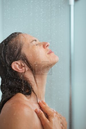 Portrait of woman bathing in shower