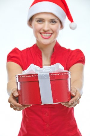 Closeup on Christmas present box in hand of smiling female
