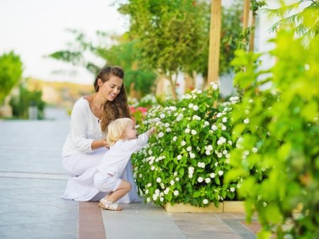 Mother and baby discover vegetable life outdoors