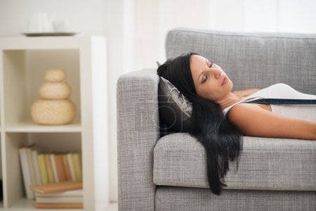 Photo for Young woman sleeping on sofa - Royalty Free Image