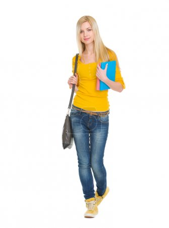 Teenage student girl with books going forward