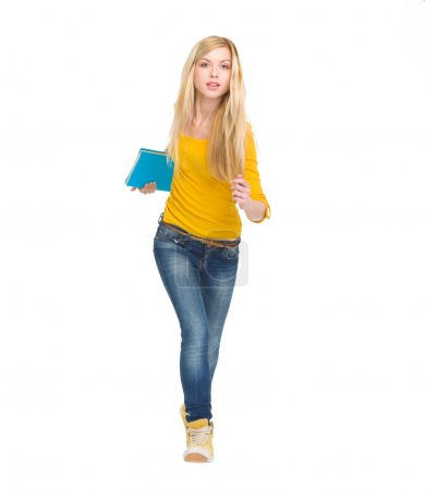Full length portrait of student girl running straight