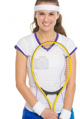 Portrait of happy female tennis player with racket