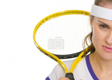 Closeup on tennis player with racket