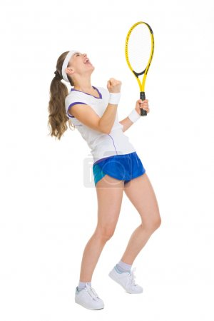 Full length portrait of happy tennis player rejoicing in success