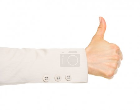 Closeup on hand of business woman showing thumbs up