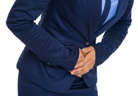 Closeup on business woman having stomach pain