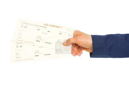 Photo pour Gros plan sur la main donnant des billets d'avion - image libre de droit