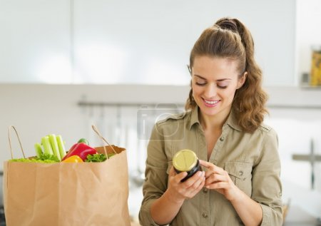 Housewife with shopping bag full of vegetables