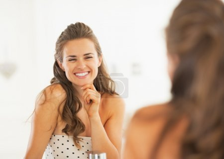 Young woman in bathroom