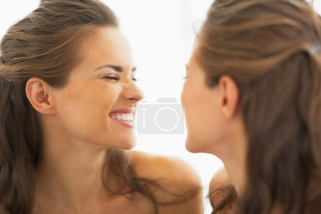 Photo for Happy young woman making funny face in mirror - Royalty Free Image