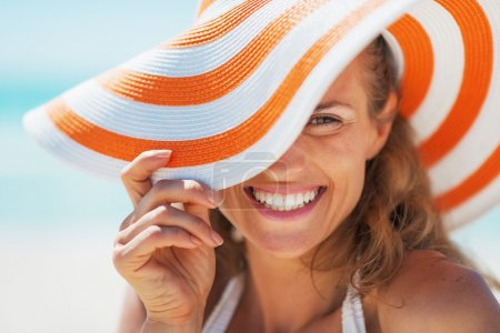 Photo for Portrait of happy young woman in swimsuit and beach hat - Royalty Free Image