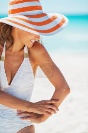 Photo for Happy young woman in swimsuit and beach hat - Royalty Free Image