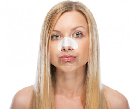 Concerned young woman with clear-up strips on nose...