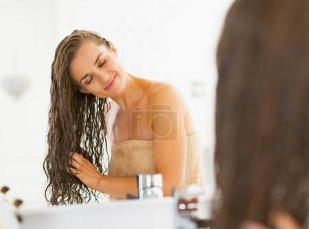 Photo for Happy young woman with wet hair in bathroom - Royalty Free Image
