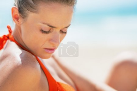 Photo for Portrait of young woman relaxing on beach - Royalty Free Image