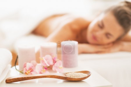 Closeup on spa therapy ingredients and relaxed young woman