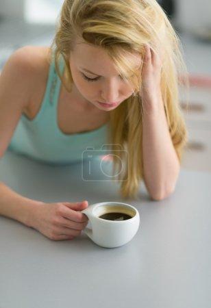 Woman having coffee after sleep