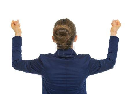 Photo pour Succès commercial femme réjouissance. vue arrière - image libre de droit