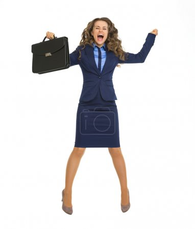 Business woman jumping with briefcase
